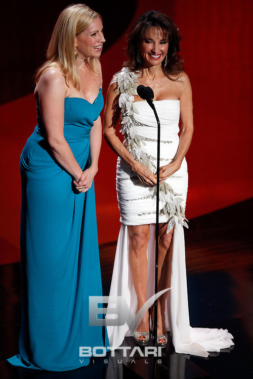 From left, Liza Huber and Susan Lucci speak onstage during the Daytime Emmy Awards on Sunday June 19, 2011 in Las Vegas. (AP Photo/Jeff Bottari)