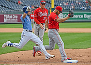 Cincinnati Reds relief pitcher Josh Osich (35) forces out Kansas City Royals base runner Andrew Benintendi (16) at first during the eighth inning at Kauffman Stadium.