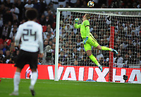 Football - 2017 / 2018 International Friendly - England vs. Germany<br /> <br /> Leroy Sane of Germany sees his shot hit the cross bar past England goalkeeper, Jordan Pickford, at Wembley Stadium.<br /> <br /> COLORSPORT/ANDREW COWIE