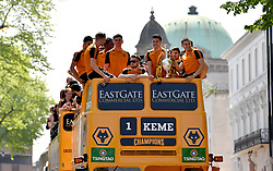 The Wolverhampton Wanderers players hold up their Sky Bet Championship trophy on the open top bus tour during the winner's parade through Wolverhampton.