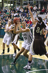 17 December 2011:  Whitney Scurlock looks past Ashley Teresiak at the goal during an NCAA womens division 3 basketball game between the St. Francis Fighting Saints and the Illinois Wesleyan Titans in Shirk Center, Bloomington IL