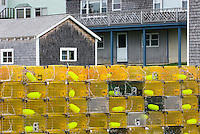 Yellow lobster traps stacked on dock, Bristol Maine, USA
