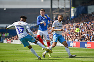 Coventry City Defender, Dujon Sterling (17) and Portsmouth Midfielder, Ronan Curtis (11) challenge fro the ball during the EFL Sky Bet League 1 match between Portsmouth and Coventry City at Fratton Park, Portsmouth, England on 22 April 2019.
