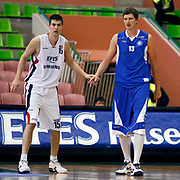 Efes Pilsen's Dusan CANTEKIN (L) and Antalya BSB's Patrick FEMERLING (R) during their Turkish Basketball league match Efes Pilsen between Antalya BSB at the Ayhan Sahenk Arena in Istanbul Turkey on Wednesday 21 April 2010. Photo by Aykut AKICI/TURKPIX