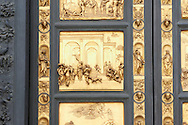 """Scenes from the early Renaissance """" Gates of Paradise"""" door of the Baptistry of Florence ( Battistero di San Giovanni ) made by Ghiberti in 1425 , made in bronze and guilded in gold. The Bapistry of the Duomo, Florence Italy.<br /> <br /> If you prefer you can also buy from our ALAMY PHOTO LIBRARY  Collection visit : https://www.alamy.com/portfolio/paul-williams-funkystock/romanesque-art-antiquities.html . Type -   Florence Baptistry  - into the LOWER SEARCH WITHIN GALLERY box. Refine search by adding background colour, place, museum etc<br /> <br />  Visit our MEDIEVAL ROMANESQUE PHOTO COLLECTIONS for more   photos  to download or buy as prints https://funkystock.photoshelter.com/gallery-collection/Medieval-Romanesque-Art-Antiquities-Historic-Sites-Pictures-Images-of/C0000uYGQT94tY_Y .<br /> <br /> Visit our ITALY PHOTO COLLECTION for more   photos of Italy to download or buy as prints https://funkystock.photoshelter.com/gallery-collection/2b-Pictures-Images-of-Italy-Photos-of-Italian-Historic-Landmark-Sites/C0000qxA2zGFjd_k<br /> .<br /> <br /> Visit our MEDIEVAL PHOTO COLLECTIONS for more   photos  to download or buy as prints https://funkystock.photoshelter.com/gallery-collection/Medieval-Middle-Ages-Historic-Places-Arcaeological-Sites-Pictures-Images-of/C0000B5ZA54_WD0s"""