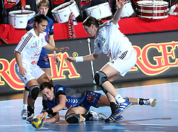 Andrea Lekic between Orsolya Verten (6) and Simona Spiridon (80) at EHF Champions league handball match in Group II between RK Krim Mercator and Gyori Audi Eto KC, on February 7, 2009, in Kodeljevo, Ljubljana, Slovenia. Gyori won 35:31. (Photo by Vid Ponikvar / Sportida)