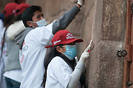 Youth groups of volunteers giving a clean surface on the city  walls