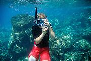 Boy snorkeling, Molokini Island, Maui, Hawaii