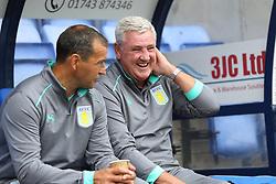 Aston Villa's assistant manager Colin Calderwood and manager Steve Bruce