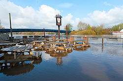 © Licensed to London News Pictures. 16/11/2019. Upton upon Severn, Worcestershire, UK. A pub garden gets flooded at Upton upon Severn. After several days of heavy rainfall, there is severe flooding in many parts of  Worcestershire, UK. Photo credit: Graham M. Lawrence/LNP