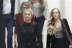 © Licensed to London News Pictures. 15/07/2020. London, UK. American actor AMBER HEARD arrives at the High Court in London where Johnny Depp is in a legal dispute with UK tabloid newspaper The Sun over allegations he assaulted his former wife, Amber Heard. Photo credit: Peter Macdiarmid/LNP
