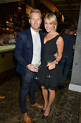 JENNI FALCONER and JAMES MIDGLEY at a party to celebrate the engagement of Natalie Coyle and Zafar Rushdie held at Library, St.Martin's Lane, London on 6th September 2014.