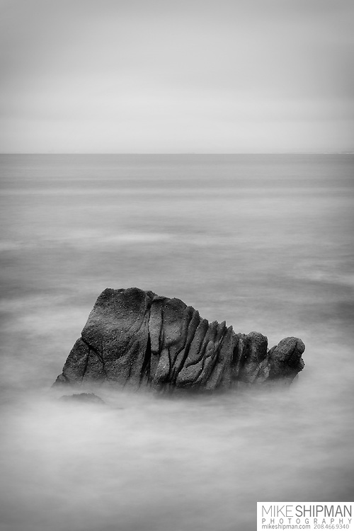Sea stack in silky surf, Lovers Point Park, Pacific Grove, California