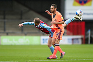 Jordan Hallam (18) of Scunthorpe United battles for possession with Dean Furman of Carlisle United during the EFL Sky Bet League 2 match between Scunthorpe United and Carlisle United at Glanford Park, Scunthorpe, England on 26 September 2020.