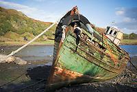 Old boat sitting on shore, Scotland
