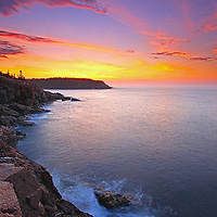 A New Day – Sunrise Maine Acadia National Park coastal photography images are available as museum quality photography prints, canvas prints, acrylic prints or metal prints. Prints may be framed and matted to the individual liking and room decor needs:<br /> <br /> http://juergen-roth.pixels.com/featured/a-new-day-juergen-roth.html<br /> <br /> Stunning sunrise seacoast photography showing a spectacular vista across the beautiful cliffs of the Maine rocky coastal shoreline in Acadia National Park. <br /> Acadia NP is a National Park located in the U.S. state of Maine. It reserves much of Mount Desert Island, and associated smaller islands, off the Atlantic coast. The park is one of the most visited wildlife areas in the United States and a paradise for every photographer and outdoor enthusiast. The park loop road provides easy access to many of the iconic photography subjects, such as Monument Cove, Sand Beach, Jordan Pond and the Bubbles, Otter Cliff to name only a few. The carriage roads and hiking trails provide further access to more remote locations where the park continues to inspire and unfolds its full magic. It is a heaven for macro, seascape, and landscape photography that makes for great wall art decoration. Especially sunrise and the light of the golden hours paint the sky in beautiful blue and orange and bring out the beauty of the pink granite rocks.<br /> <br /> Good light and happy photo making! <br /> <br /> My best, <br /> <br /> Juergen <br /> Website: www.RothGalleries.com<br /> Twitter: @NatureFineArt<br /> Facebook: https://www.facebook.com/naturefineart<br /> Instagram: https://www.instagram.com/rothgalleries