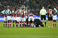 West Ham players look on as their teammate Manuel Lanzini of West Ham United is injured and seen by the medical team as he lies on the ground. Premier league match, West Ham Utd v Hull city at the London Stadium, Queen Elizabeth Olympic Park in London on Saturday 17th December 2016.<br /> pic by John Patrick Fletcher, Andrew Orchard sports photography.