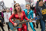 Costumed demonstrators play music during the Women's March on Washington in protest to President Donald Trump January 21, 2017 in Washington, DC. More than 500,000 people crammed the National Mall in a peaceful and festival rally in a rebuke of the new president.