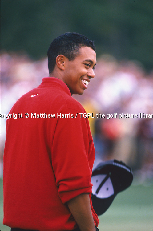 Tiger WOODS (USA) is all smiles on the 18th green after winning his first major by 12 shots from Tom KITE (USA) during fourth round US Masters 1997,Augusta National, Augusta,Georgia,USA.