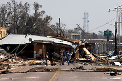 26 Sept, 2005. Cameron, Louisiana. Hurricane Rita aftermath. <br />  The destroyed remains of  downtown business in Cameron, Louisiana two days after the storm ravaged the small town. FEMA officials show journalists around the devastated town.<br /> Photo; ©Charlie Varley/varleypix.com
