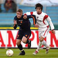 Roma 3/3/2004 Uefa Cup Third Round <br />Roma Gaziatenspor 2-0 (AS Roma qualified) <br />Daniele De Rossi (Roma) challenged by Ibrahim Toraman (Gaziatenspor)<br />Foto Andrea Staccioli Digitalsport