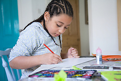 Little girl drawing a picture,