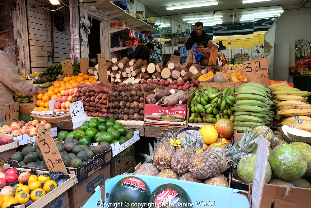 Fruit and vegetable display in front of greengrocers in Brixton South London