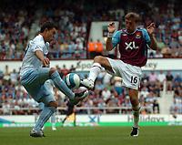Photo: Tony Oudot. <br /> West Ham United v Manchester City. Barclays Premiership. 11/08/2007. <br /> West Hams Mark Noble challenges Valeri Bojinov of Manchester City