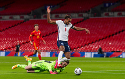 LONDON, ENGLAND - Thursday, October 8, 2020: England's Dominic Calvert-Lewin rounds Wales' goalkeeper Wayne Hennessey during the International Friendly match between England and Wales at Wembley Stadium. The game was played behind closed doors due to the UK Government's social distancing laws prohibiting supporters from attending events inside stadiums as a result of the Coronavirus Pandemic. England won 3-0. (Pic by David Rawcliffe/Propaganda)
