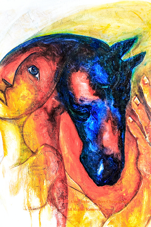 Love of Horses: A painting of a horse head dominates the image of a sad woman; with a hand that is petting the horse, Havana Cuba.