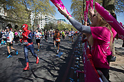 London, UK. Sunday 13th April 2014. Competitors running in the main public event of the Virgin Money London Marathon 2014. These runners take part and raise huge sums fo money for charity organisations. People from various charities come along to support their fund raisers.