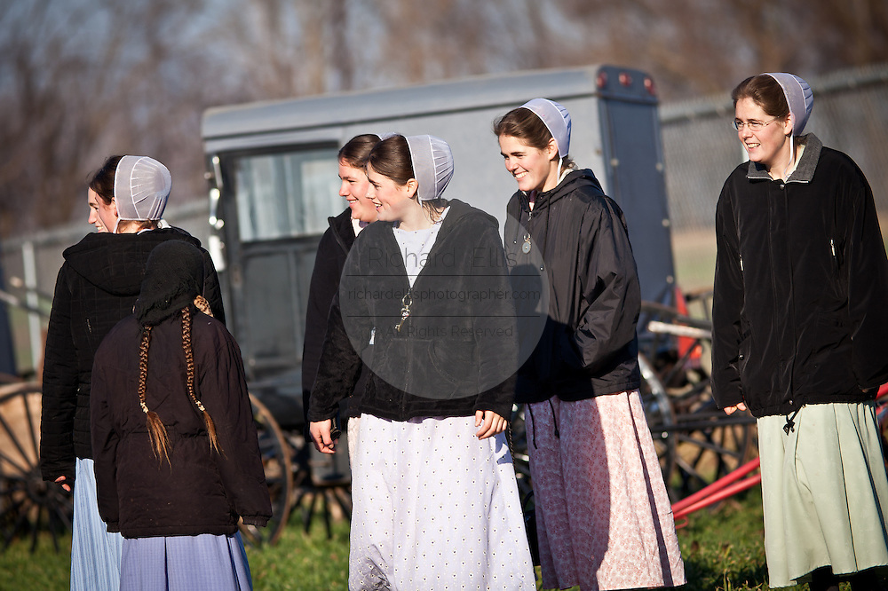Amish girls laugh at the Annual Mud Sale to support the Fire Department  in Gordonville, PA.