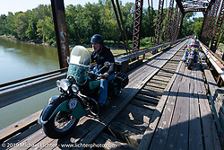 Jason Wadzinski riding Jess, his 1947 Indian Chief, across the old wooden Wabash-Cannonball Bridge on the Illinois and Indiana border during the Cross Country Chase motorcycle endurance run from Sault Sainte Marie, MI to Key West, FL (for vintage bikes from 1930-1948). As bikes crossed the wooden Wabash Cannonball railroad bridge built in 1897, it was pretty as can be but the warped boards that formed the narrow tracks made great bar stories for the rest of the trip. This was part of the 315 mile stage 4 ride from Urbana, IL to Bowling Green, KY USA. Monday, September 9, 2019. Photography ©2019 Michael Lichter.