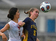 OFallon defender Mackenzie James (right) heads the ball under pressure from Edwardsville midfielder Olivia Baca. OFallon defeated Edwardsville in a girls soccer playoff game at OFallon High School in OFallon, IL on Tuesday June 8, 2021. <br /> Tim Vizer/Special to STLhighschoolsports.com.