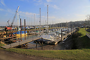Boats at moorings in marina, Tidemill Yacht harbour, River Deben, Woodbridge, Suffolk, UK