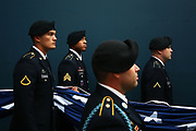 Members of the armed forces hold the flag in the tunnel before the Seahawks game against the Panthers, Sunday, October 18, 2015.