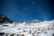 Rylan Bowers hikes near Lower Crystal Lake and Crystal Peak, moonlit at night in the Tenmile Range, Arapaho National Forest, Colorado.