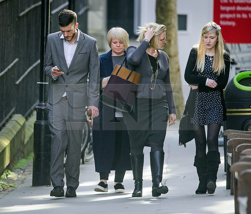 © Licensed to London News Pictures. 03/04/2017. London, UK. CHRIS GARD  (far left) and )CONNIE YATES (far right)  arrive at the The Royal Courts of Justice in London where a High Court judge is due to rule whether doctors can withdraw life-support treatment to their son, Charlie, who suffers from a rare genetic condition. Doctors at Great Ormond Street Hospital in London say eight-month-old Charlie should be left to die in dignity, but his parents have raised £1.2 million for specialist treatment in America.  Photo credit: Ben Cawthra/LNP
