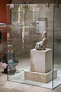 A tourist views Señor de las Limas, an Olmec stone sculptures on display at the Museum of Anthropology in the historic center of Xalapa, Veracruz, Mexico. The Olmec civilization was the earliest known major Mesoamerican civilizations dating roughly from 1500 BCE to about 400 BCE.