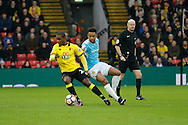Watford striker Odion Ighalo (24) and Burton Albion midfielder Lee Williamson (7) during the The FA Cup 3rd round match between Watford and Burton Albion at Vicarage Road, Watford, England on 7 January 2017. Photo by Richard Holmes.