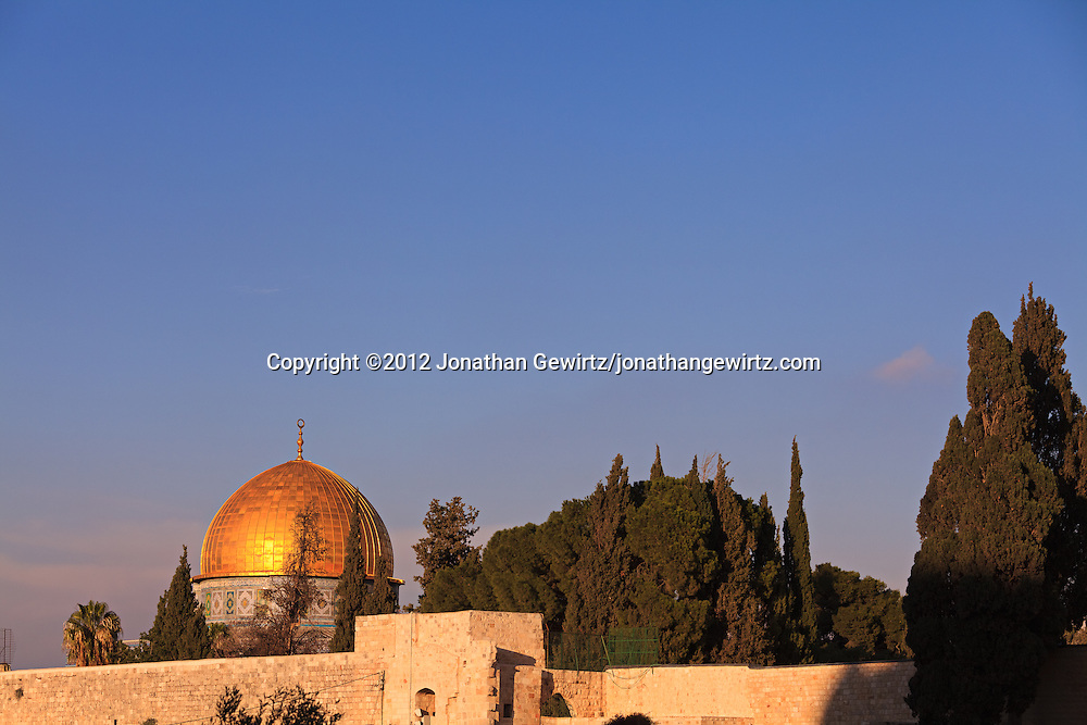 The golden Dome of the Rock reflects afternoon sunlight over the Western Wall and Temple Mount WATERMARKS WILL NOT APPEAR ON PRINTS OR LICENSED IMAGES.