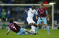 Photo: Aidan Ellis.<br /> Bolton Wanderers v West Ham Utd. Carling Cup.<br /> 26/10/2005.<br /> West Ham's Christian dailly tackles Bolton's Amdy Faye