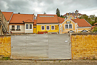 View of a brick wall, Hungarian buildings, and the Red Lion Pub, Szentendre, Hungary.