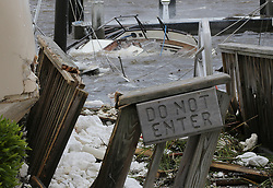 September 11, 2017 - St. Marys, Georgia, U.S. - A dock comes to quick end and a destroyed cabin boat sits on the bottom after Hurricane Irma swept through the town on Monday. (Credit Image: © Curtis Compton/TNS via ZUMA Wire)