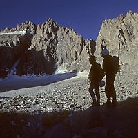 Climbers approach the Palisade Glacier en route to climbing [Mount] North Palisade (L) in California's Sierra Nevada.  On the left is Thunderbolt Peak.