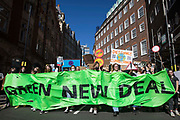 Hundreds of young people march during a Global Climate Strike to demand intersectional climate justice on 24th September 2021 in London, United Kingdom. The Global Climate Strike was organised to highlight the detrimental influences through colonialism, imperialism and exploitation of the Global North on MAPA Most Affected Peoples and Areas, which have contributed to them now experiencing the worst impacts of the climate crisis, and to call on the Global North to pay reparations to MAPA.