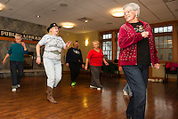 Bonnie Deutch leads a line dancing class at the Gilford Library on Wednesday morning.  Kicking up their heels (l-r front row) Jo Clark, Bonnie Deutch, Ellie Prior.  (back row) Nancy Milligan, Leslie Berghahn, Joyce Papps and Anita Souter.  (Karen Bobotas/for the Laconia Daily Sun)
