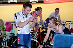 Jason Kenny (left) speaks to Laura Kenny during Day Three of the Six Day Series Manchester at the HSBC UK National Cycling Centre.