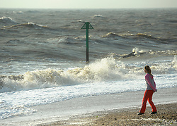 © Licensed to London News Pictures. 24/10/2011. Felixstowe, UK. A young girl plays near waves. Windy weather along Felixstowe promenade today 24th October 2011. Parts of the UK are braced for wet and windy weather over the next 24hrs . Photo: Stephen Simpson/LNP