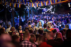 """© Licensed to London News Pictures . 22/08/2014 .  Manchester , UK . Two drag queens amongst the crowd on Canal Street . Manchester Pride """" Big Weekend """" in Manchester's """" Gay Village """" today ( 22nd August 2014 ) . Photo credit : Joel Goodman/LNP"""